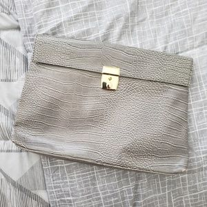 Urban Outfitters faux snakeskin oversized clutch
